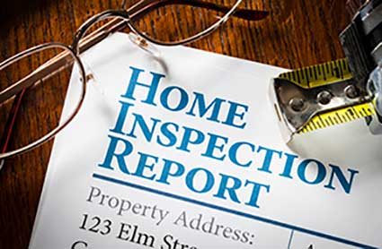 home-inspection-report-with-tape-measurea-and-glasses-on-a-wooden-table-top3