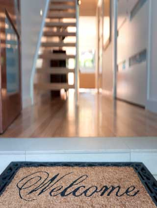 welcome-mat-with-door-open-and-stair-case